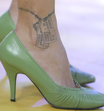 Pinks Dog Tags Tattoo on Her Ankle