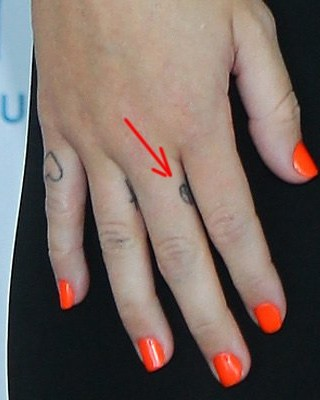 Miley Cyrus Peace Tattoo on Her Finger