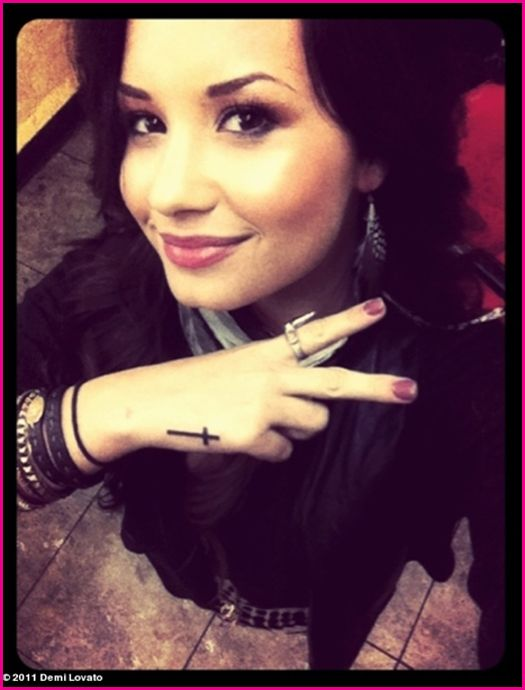 Demi Lovato's Cross Hand Tattoo