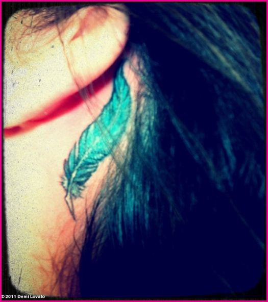 Demi Lovato Feather Tattoo Behind Her Ear