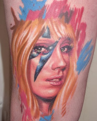 Man's Colorful Fan Tattoo Inspired by Lady Gaga