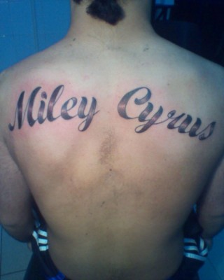 "Dude Got ""Miley Cyrus"" Tattooed on His Back"