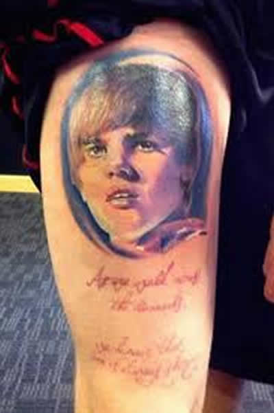 Weird and a little scary tattoos of justin bieber for Strange world tattoos