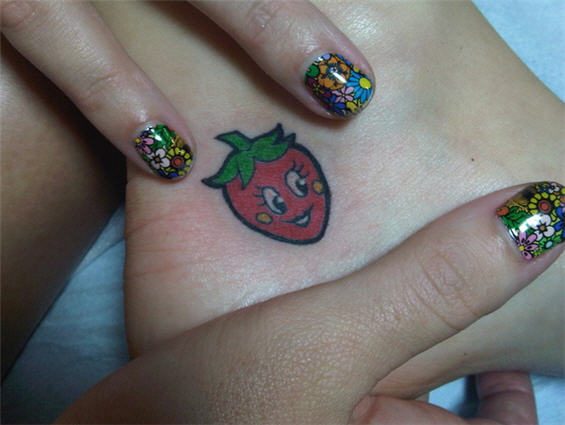 Katie Perry's Ankle Strawberry Tattoo