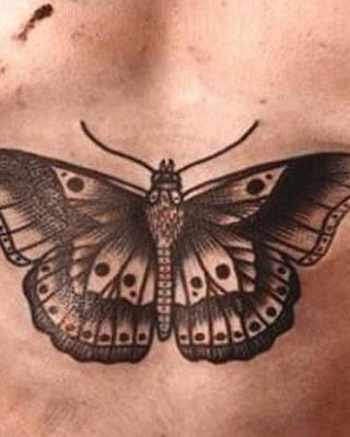 Harry Styles' Oddly Large Butterfly Chest Tattoo