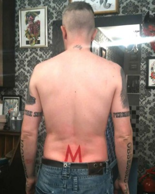 Miley Cyrus Obssesed Fan Adds Even More Tattoos!