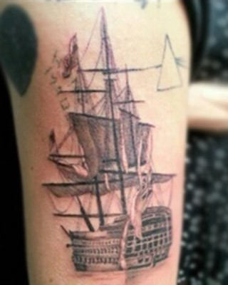 "Harry Styles' Ship, Pink Floyd, and ""Home Made"" Tattoos on His Arm"