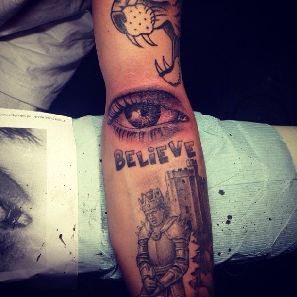 justin bieber adds an eye tattoo to his almost sleeve