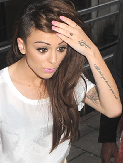 Cher Lloyd's Treble Clef Hand Tattoo