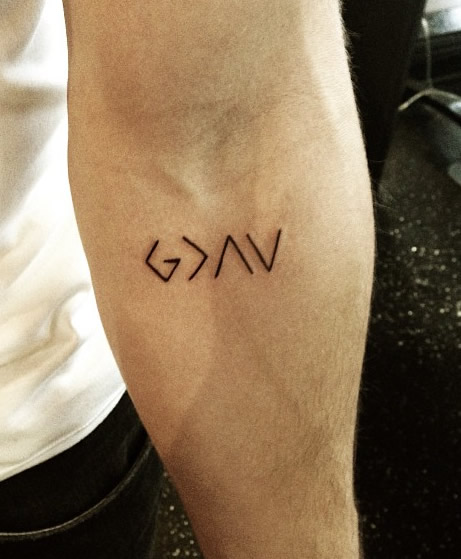Nick Jonas Reveals New Religious Arm Tattoo