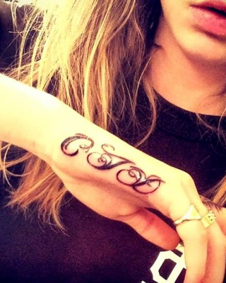 "Cara Delevingne's ""CJD"" Initials Tattoo on Her Hand"