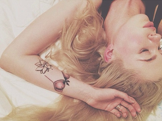 Ireland Baldwin Got a New Arm Tattoo…Of a Pink Lace Bra!