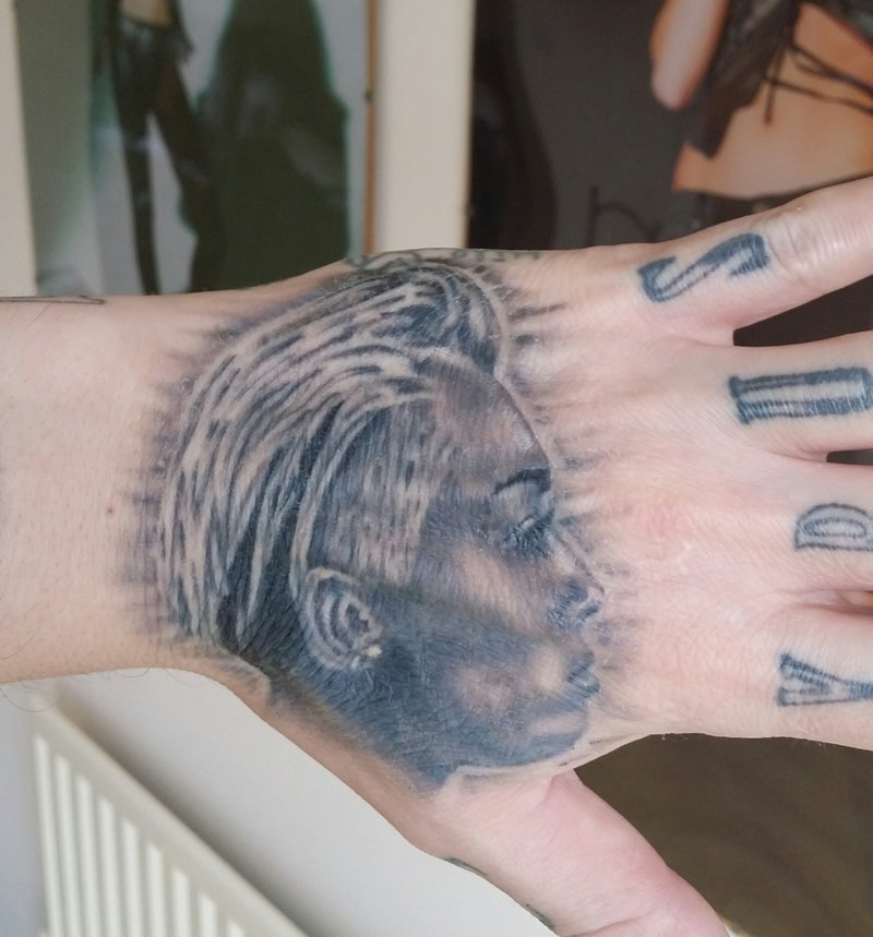 Miley Cyrus Fanatic Carl McCoid Debuts New Portrait Tat on His Hand, Making 23 Miley Tats