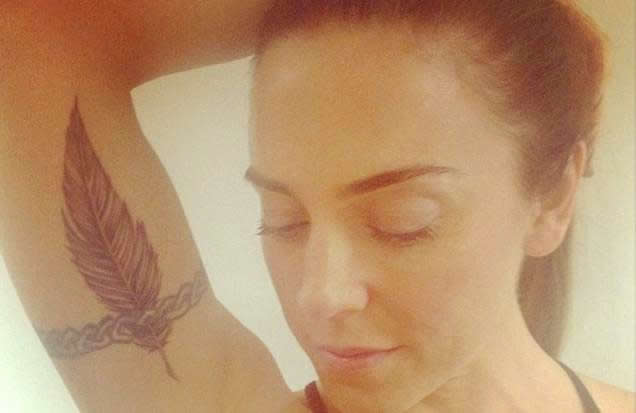 ... Girl Mel C Adds Feather Tattoo to Celtic Arm Band Ink- PopStarTats