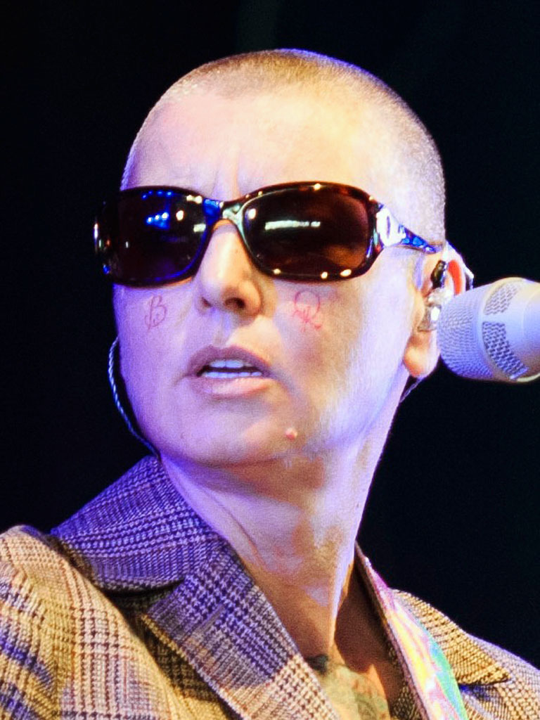 "Sinead O'Connor Finally Decides to Get ""B"" and ""Q"" Face Tattoos Removed"