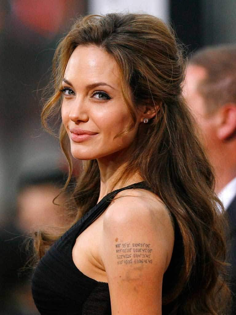 "Jolie-Pitt Kids are ""Obsessed"" With Angelina's Tattoos"