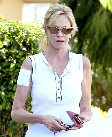 "An Aging Melanie Griffith Ditches the Cover-Up and Opts for Legit Removal of ""Antonio"" Tat"