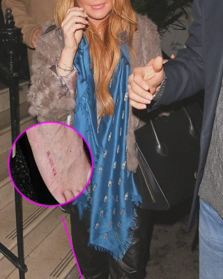 "Lindsay Lohan Shows Off Red ""Be Here Now"" Foot Tat in London"