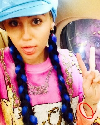 "Miley Cyrus Marks Melbourne Arrival With New Wrist ""Wukong"" Tattoo Dedicated to Brother Braison"