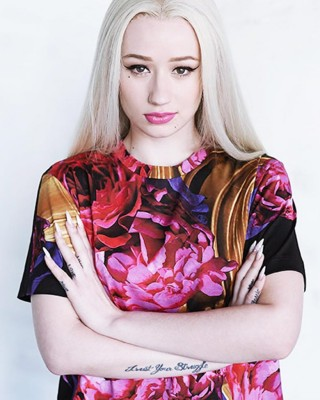 "Iggy Azalea's Arm Tattoo Reading ""Trust Your Struggle"""