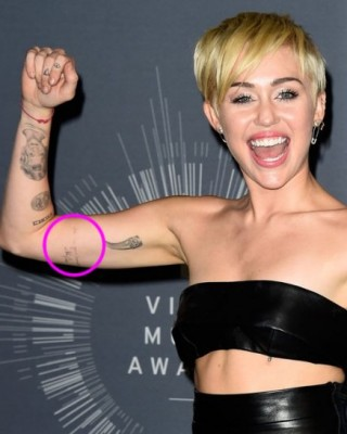 """Miley Cyrus' """"I'm In Your Corner"""" Johnny Cash Tattoo on Her Bicep"""
