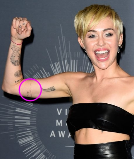 "Miley Cyrus' ""I'm In Your Corner"" Johnny Cash Tattoo on Her Bicep"