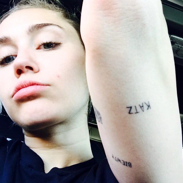 miley cyrus shows off katz arm tattoo and another new