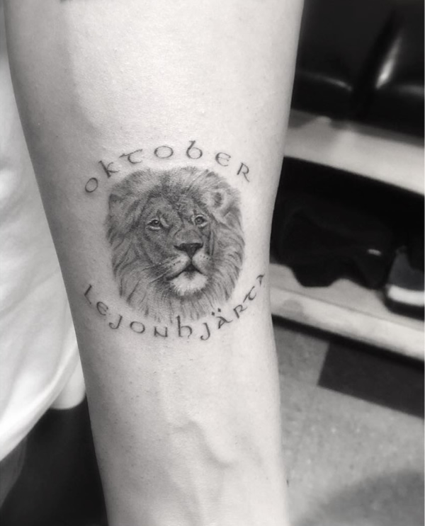 Drake honors brand favorite month with oktober lion for Drake new tattoo