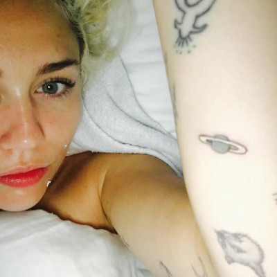 Miley Cyrus' New Planet Tattoo is Confusing as Hell