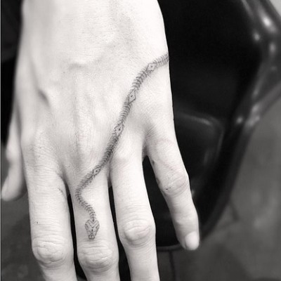 Amber Heard Designs a New Snake Skeleton Hand Tattoo for Cara Delevingne