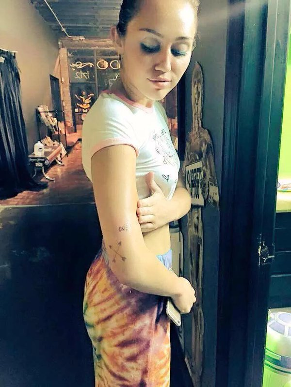 "Miley Cyrus Has a Red ""OKIE"" Tattoo on Her Arm"